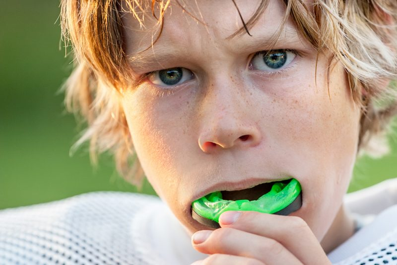 Boy putting in his sports mouth guard